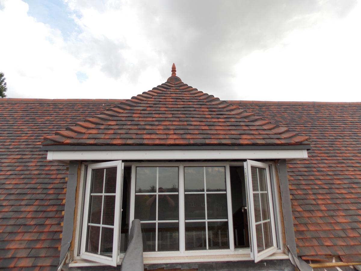 front view of dormer window with spike roof finial