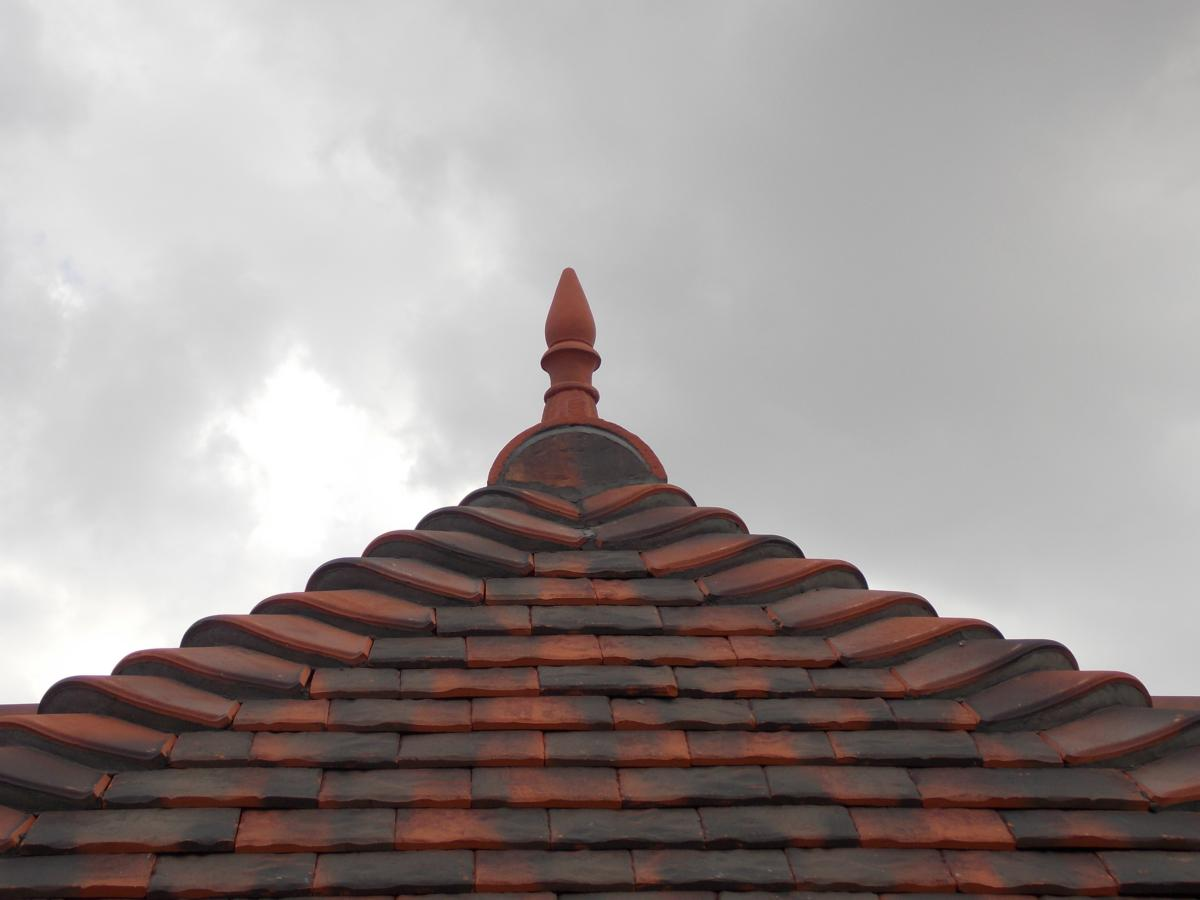 front view of spike roof finial installed on the roof